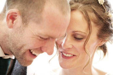 Happy Bride-and-Groom-laughing-Together