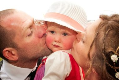 Couple-Kissing-Daughter