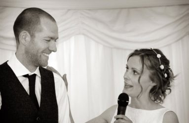 Bride Makes-a-Speech-While-Groom-Laughs